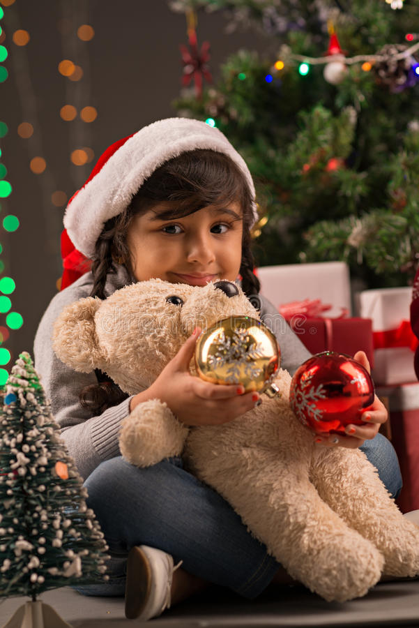 Girl in Santa Claus hat stock photography