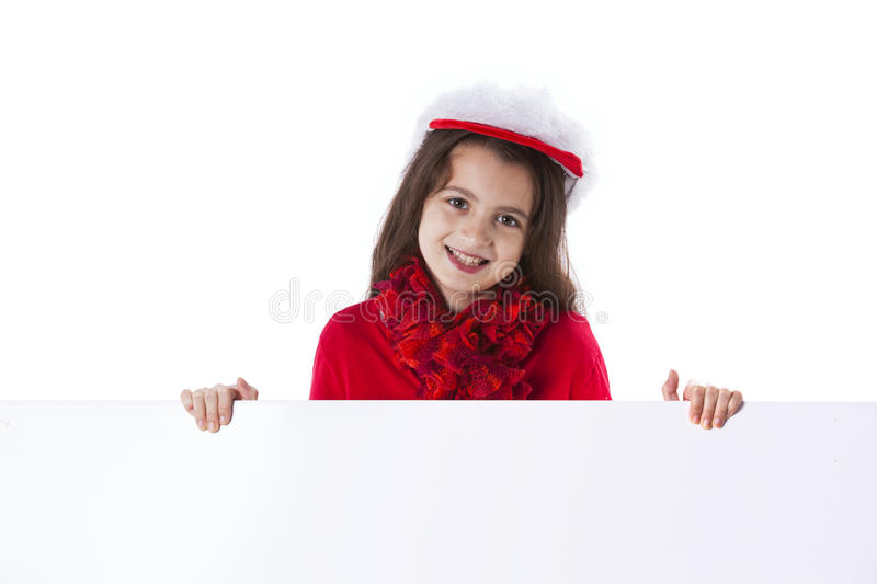 Girl with a santa claus hat. Litte girl with a santa claus hat stock image