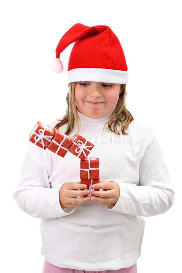 Download Girl In Santa Hat With Falling Presents Isolated Stock Photo - Image: 16867438