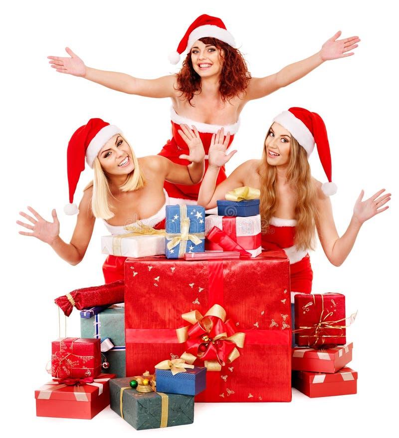 Girl in Santa hat holding Christmas gift box. royalty free stock photos