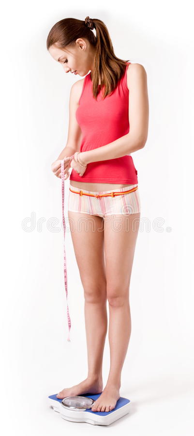 Download Girl on scales stock photo. Image of skinny, cheerful - 14965688