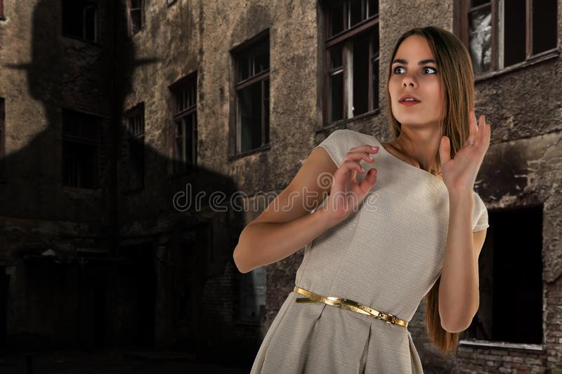 Girl scared by the shadow on the wall royalty free stock images