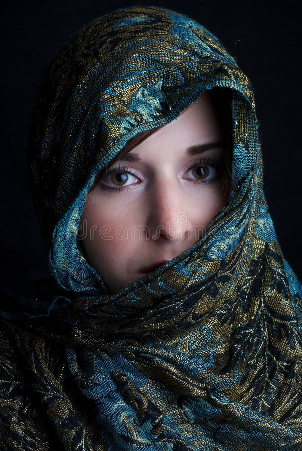 Girl in a scarf royalty free stock image