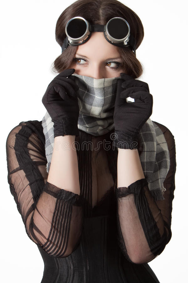 Girl with scarf and goggles. Girl with scarf and googles isolated over white royalty free stock images