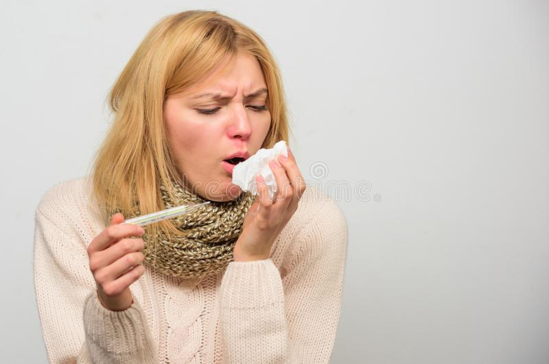 Girl in scarf hold thermometer and tissue close up. Cold and flu remedies. Take temperature and assess symptoms. Measure. Temperature. High temperature concept stock photo
