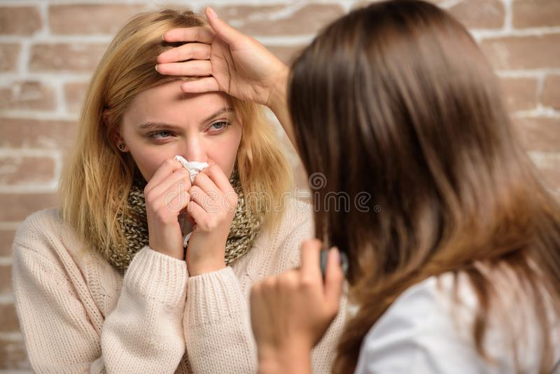 Girl in scarf hold tissue while doctor examine her. Recognize symptoms of cold. Remedies should help beat cold fast. Cold and flu remedies. Tips how to get rid royalty free stock images