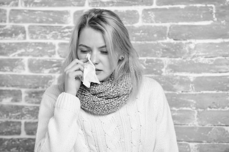 Girl in scarf hold tissue or napkin suffer headache. Runny nose symptom of cold. Tips how get rid of cold. Cold and flu. Remedies. Remedies should help beat royalty free stock photography