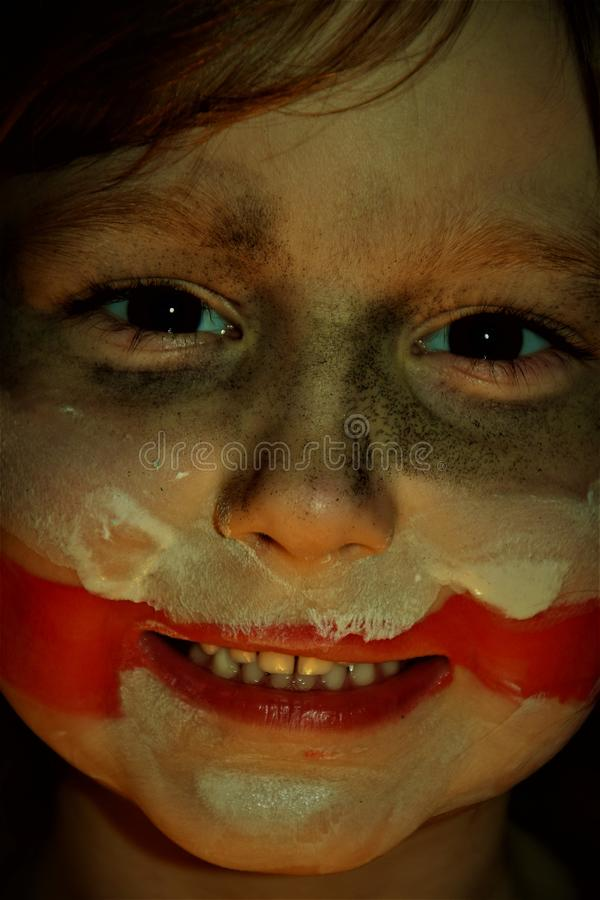 A girl with a scarred face. Face on the style of the joker stock photography