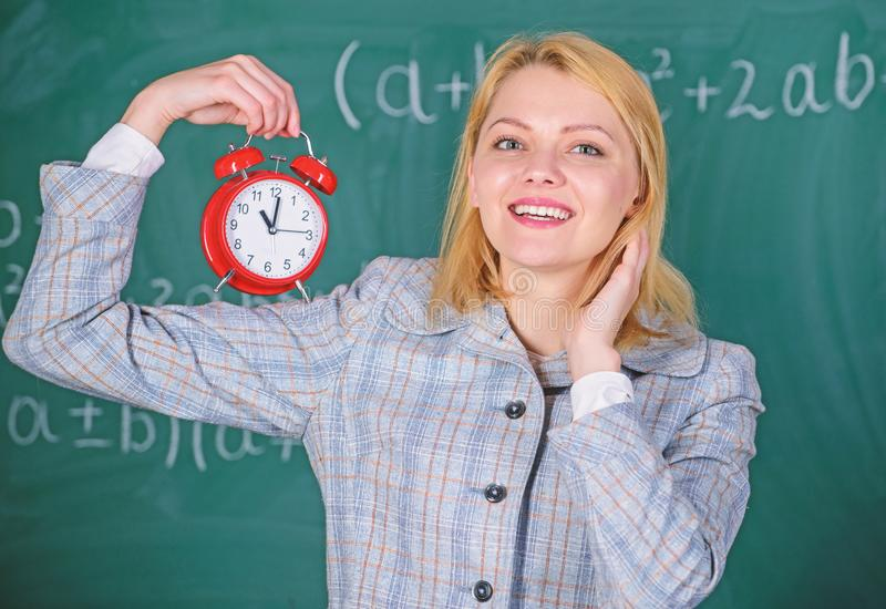 Girl school lecturer. Welcome teacher school year. Health and daily regime. Educator start lesson. She cares about royalty free stock image