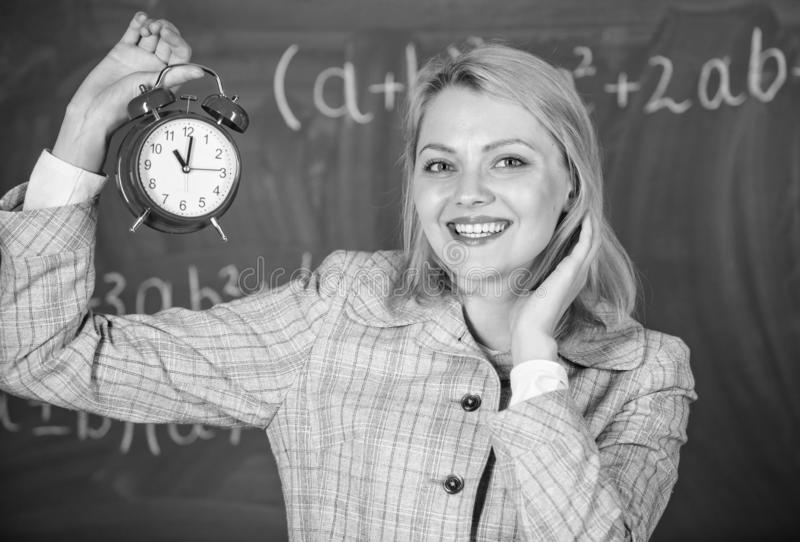Girl school lecturer. What time is it. Lessons schedule. Welcome teacher school year. Health and daily regime. Educator royalty free stock photography