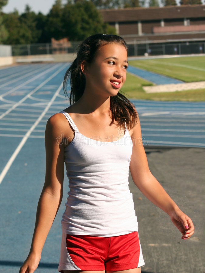 Girl at school stadium stock images