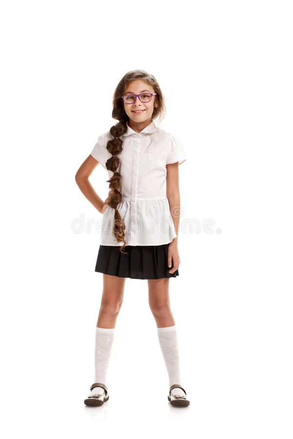 Girl in school uniform. Full portrait of little cute girl posing in school uniform royalty free stock photography