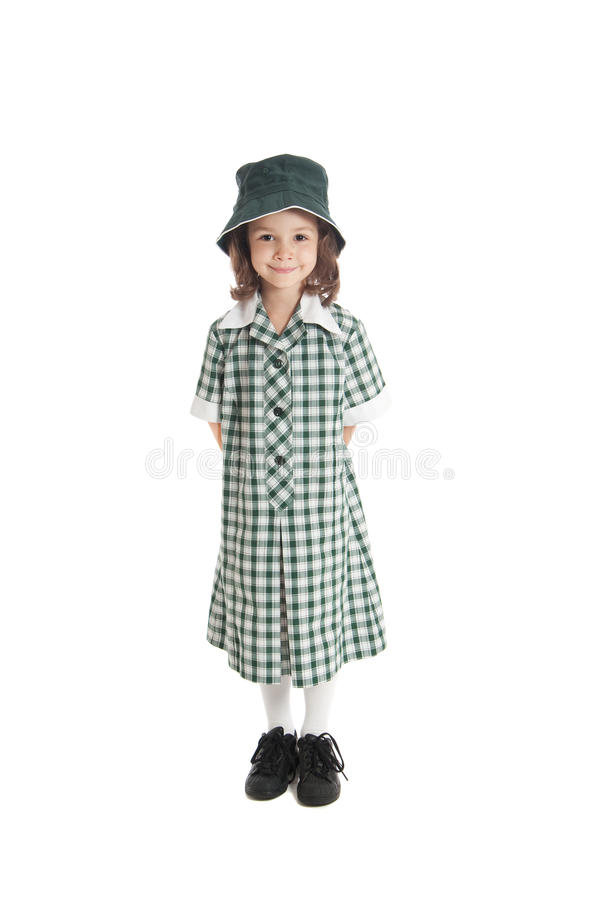 Girl in school uniform and sun hat isolated. Young girl in school uniform and sun hat. Isolated on white royalty free stock photo