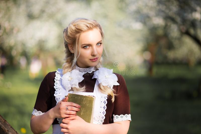 Girl in a school uniform of the USSR stock images