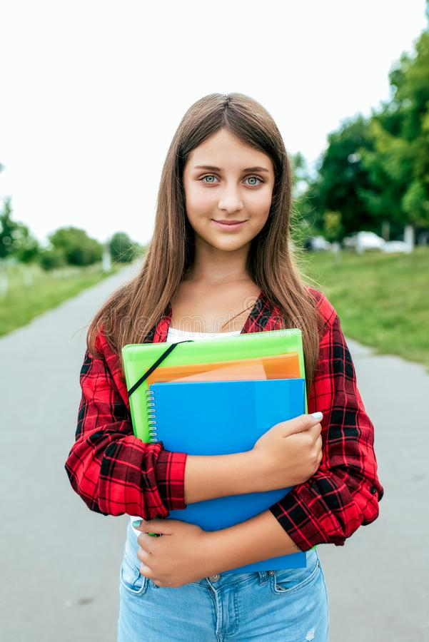 Free Girl Schoolgirl Teenager 10-15 Years Old, Summer City After School Lessons. In Hands Documents And Notebooks Notes Royalty Free Stock Photos - 140698718