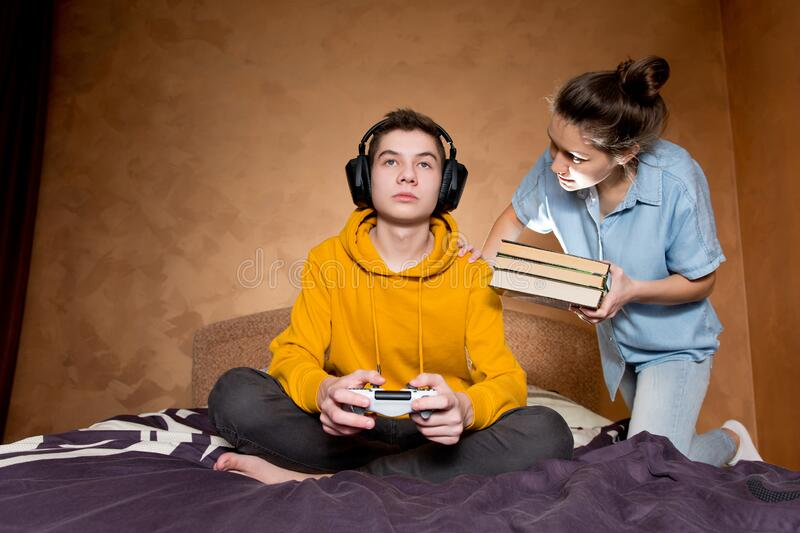 The girl scolds a young man who is passionate about a computer game royalty free stock photos
