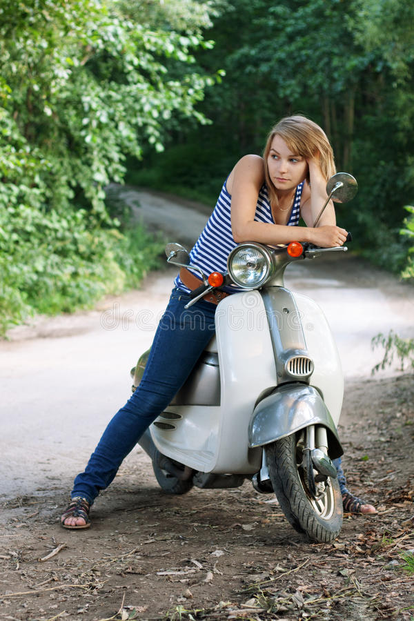 Download Girl on a scooter stock image. Image of attractive, nature - 20564737