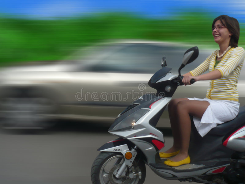 Girl on scooter royalty free stock image