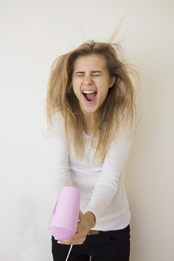 Girl screaming and blowing her hair royalty free stock photos