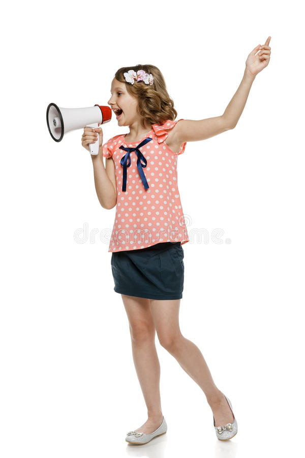 Girl Screaming Into Megaphone Royalty Free Stock Photos