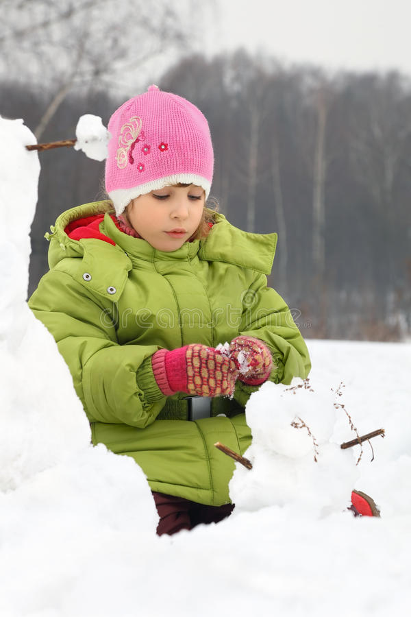 Download Girl Sculpt From Snow Much Snowman Stock Photo - Image: 20004462