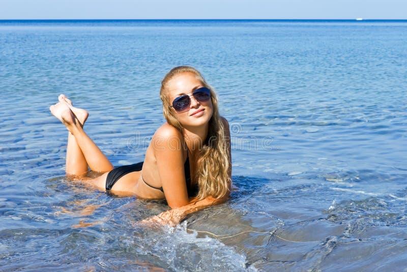 Download The girl and the sea. stock photo. Image of coast, bikini - 17780460