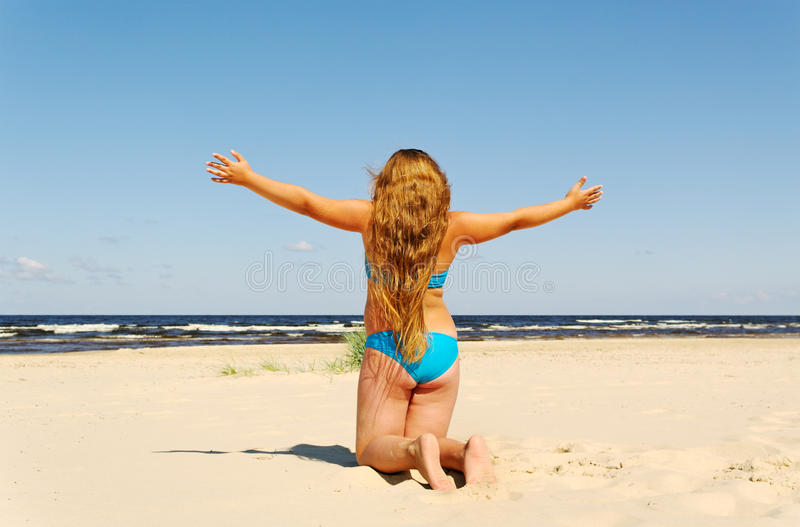 Girl at the sea. royalty free stock image