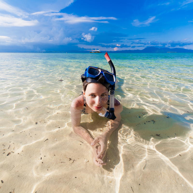 Girl into the sea with mask royalty free stock image