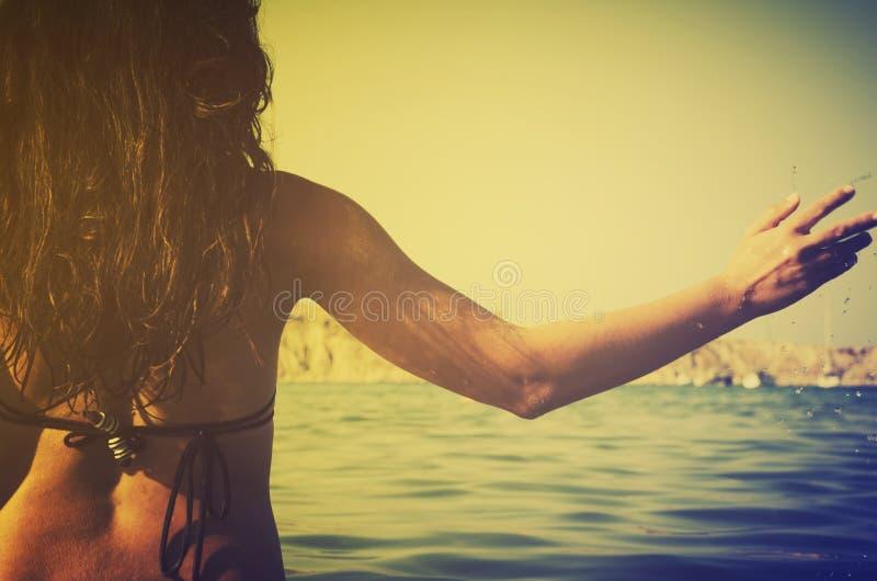 Girl in the sea royalty free stock photos