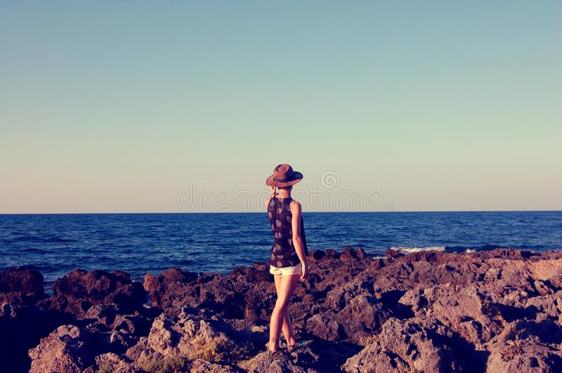 Girl on the sea shore. royalty free stock photography