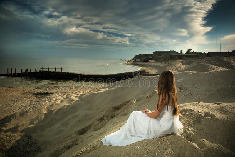 The girl and the sea. stock photo