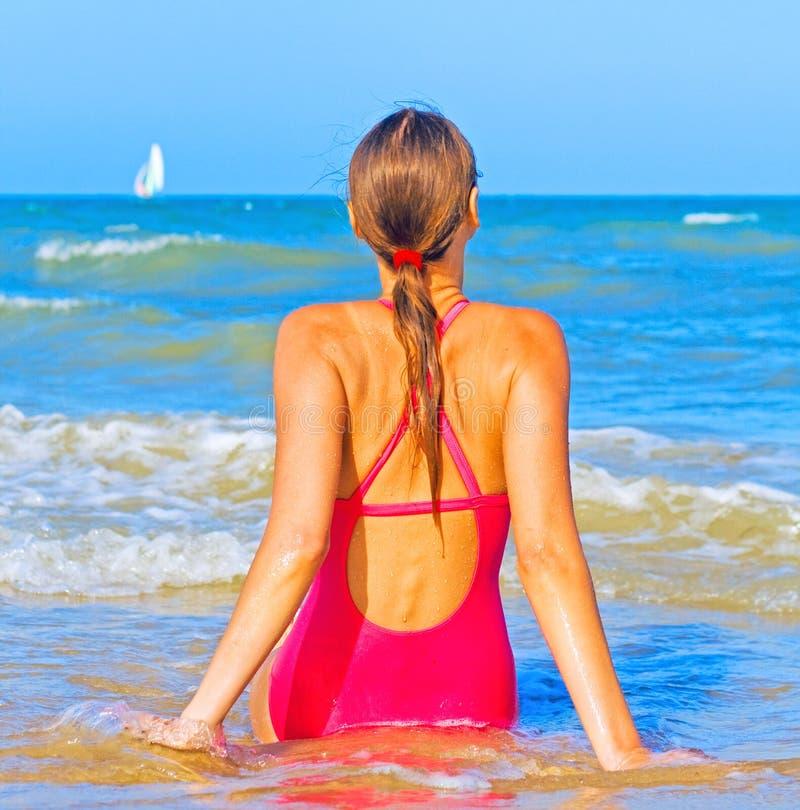 Girl in sea water stock image