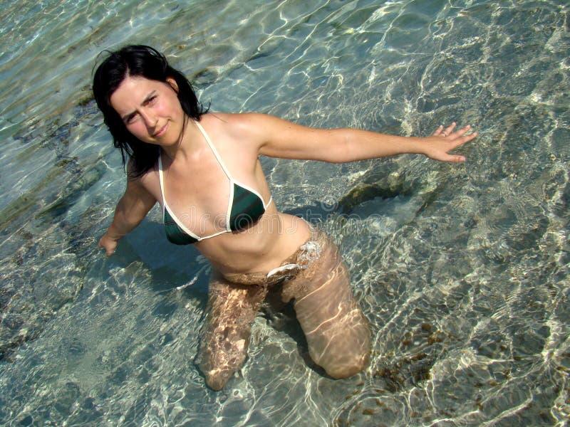 Girl and sea water. Girl enjoying sea bath playing with water stock photos