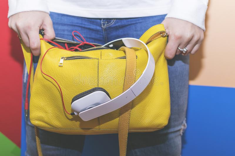 The girl searches for something in his bag. Women`s handbag. royalty free stock image