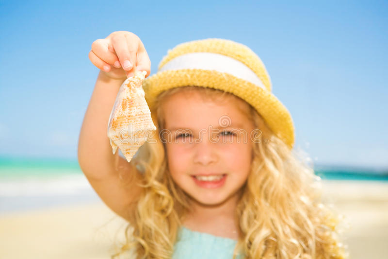Download Girl with seashell stock photo. Image of tropical, field - 13359448