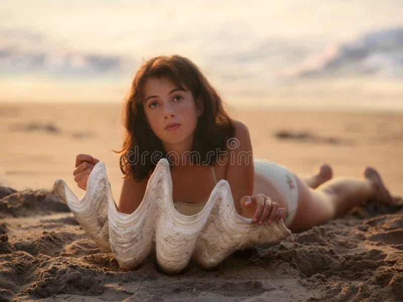 Girl with seashell stock photo