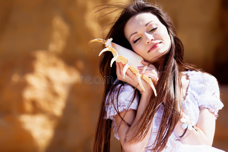 Download Girl with seashell stock image. Image of brunette, happiness - 24499795