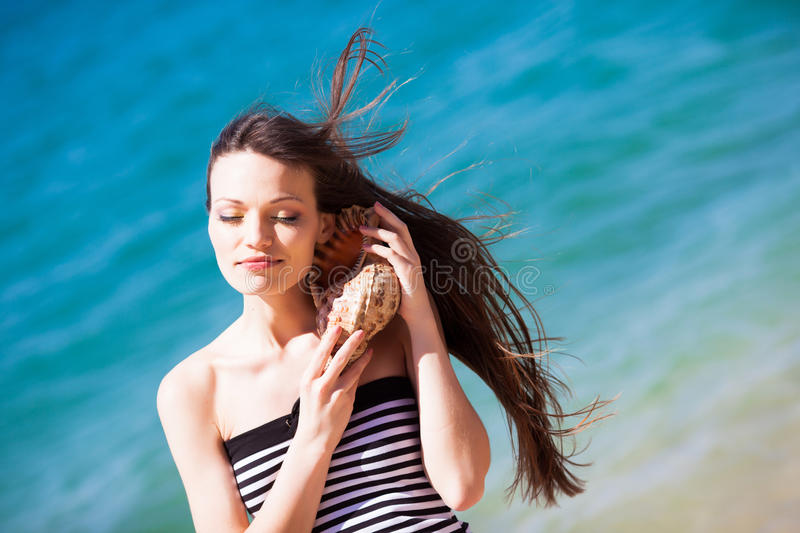 Download Girl with seashell stock photo. Image of holding, happy - 24499866