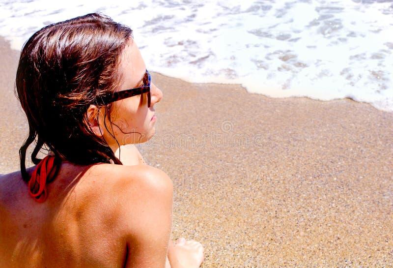 Girl on seaside royalty free stock photography