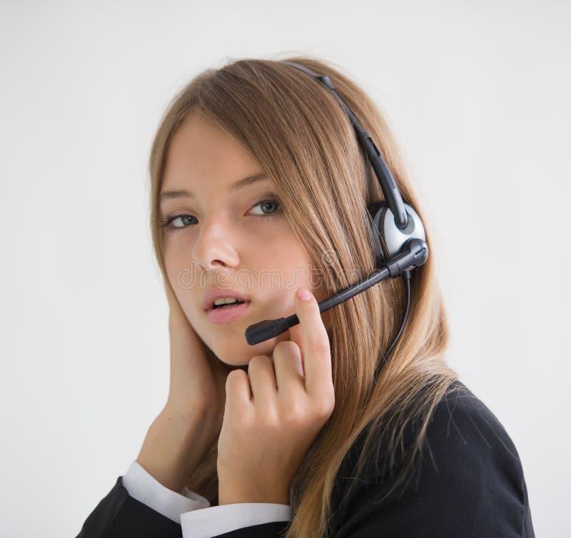 Girl secretary talking. On the speakerphone stock images