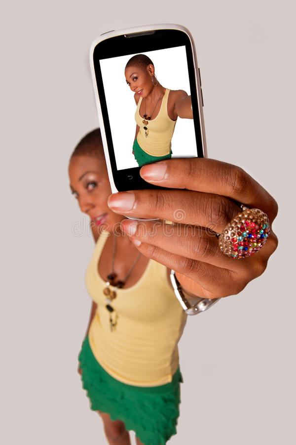 Girl selfie. African American lady taking a selfie royalty free stock photo