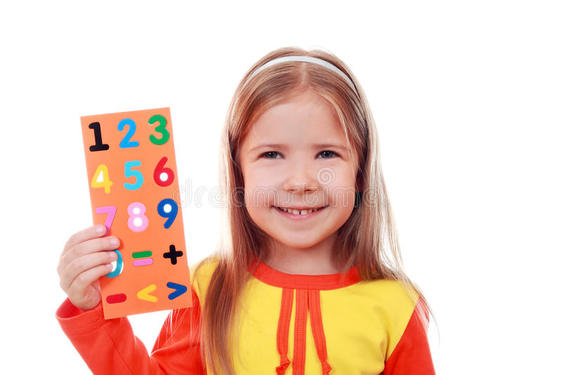 Girl with a set of digits. For teaching mathematics royalty free stock photography