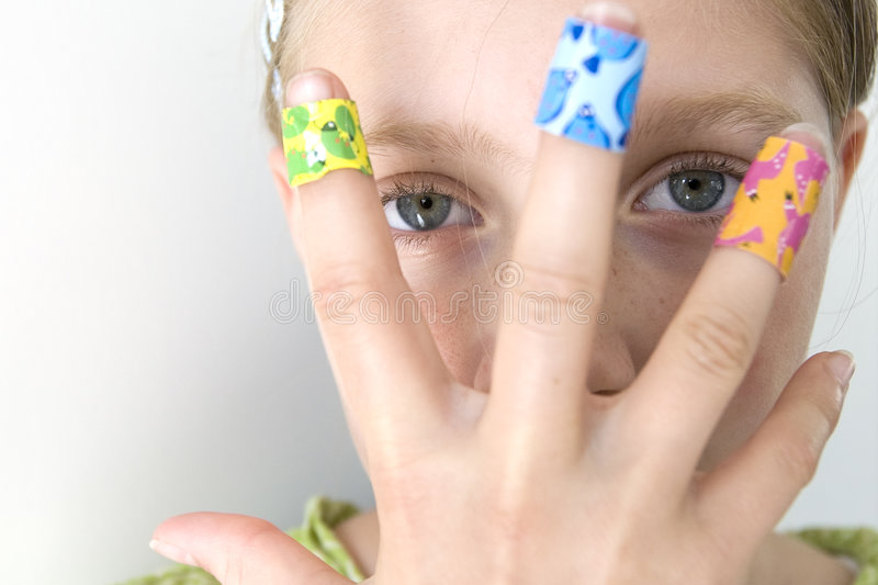 Girl with several colorful bandages stock photos