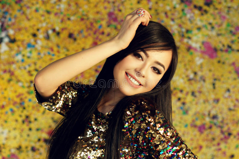 Girl in shiny party dress royalty free stock photography