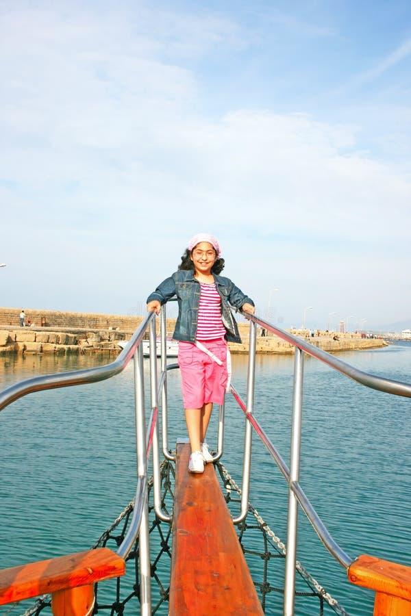 Girl on ship royalty free stock photo