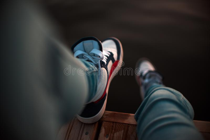 Girl is shod sports sneakers stock photography