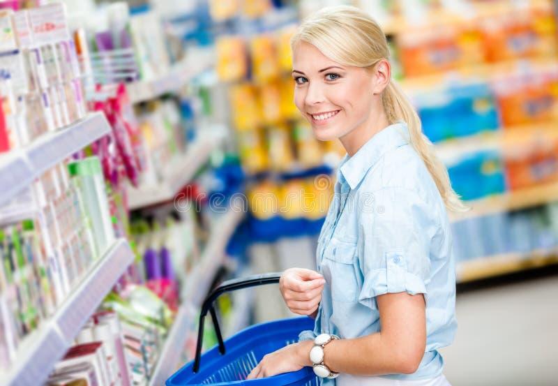 Girl at the shop choosing cosmetics stock image