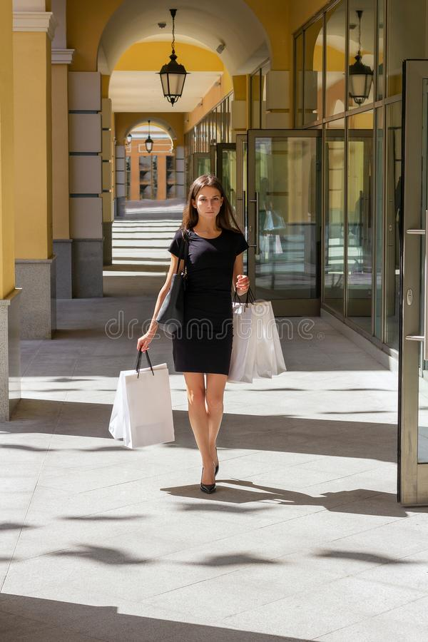 Girl shopaholic shopping  purchase  serious  fashion royalty free stock photography