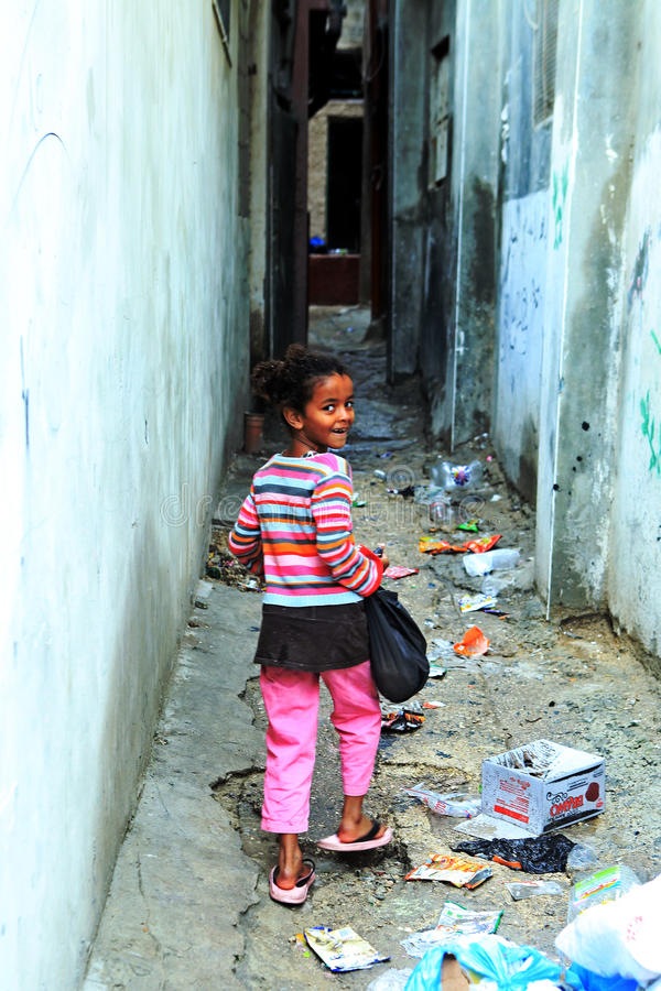 Girl with shopping bag in the street of Ramallah. Refugee camp Aida royalty free stock photos
