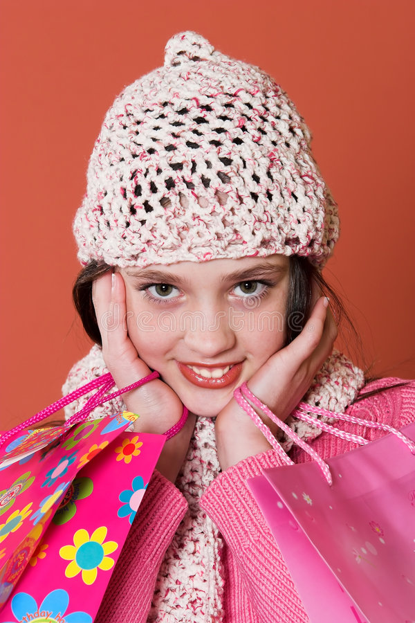 Girl with shopping bags. Pretty girl with shopping bags royalty free stock photos